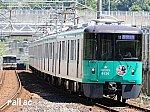 北神急行線市営化記念ヘッドマークを掲出する神戸市交通局6000系西神中央側先頭車