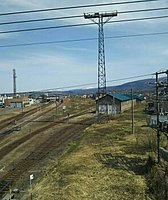 grass, sky, outdoor, track, railroad, outdoor object, pylon, traveling, power line