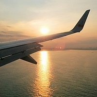 outdoor, sky, water, plane, airplane, aircraft, transport, sunset, cloudy, clouds, land, engine, distance, island