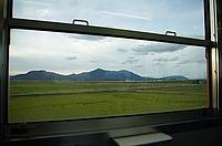 window, grass, indoor, train, view, landscape, travel, mountain, road
