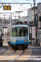 road, outdoor, street, train, text, land vehicle, vehicle, city, driving, station, traveling, busy, way