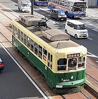 road, outdoor, vehicle, land vehicle, car, train, tram, street, transport, bus, streetcar, city, busy