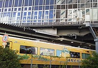 building, outdoor, train, vehicle, text, land vehicle, bus, traveling, apartment building