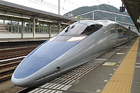 train, track, vehicle, station, platform, transport, land vehicle, bullet train, high-speed rail, public transport, railway, transport hub, rolling stock, pulling