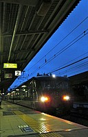 train, track, rail, land vehicle, vehicle, locomotive, platform, text, station, train station, long, traveling, railroad, steel