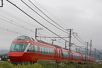 sky, outdoor, train, track, grass, transport, vehicle, rail, land vehicle, long, traveling, railroad, day
