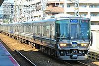 building, outdoor, transport, train, vehicle, land vehicle, railroad, rail, city, blue