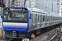 outdoor, track, land vehicle, vehicle, transport, blue, train, city, public transport, traveling, pulling, day