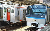 train, land vehicle, vehicle, text, railroad, station, rail, public transport, rolling stock, several