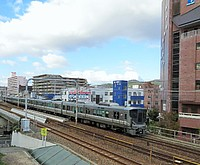 sky, building, train, outdoor, track, railroad, vehicle, city, land vehicle, rail, station