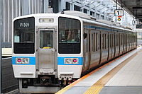 train, transport, building, track, outdoor, platform, land vehicle, station, vehicle, public transport, railroad, rail, rolling stock, pulling, stopped