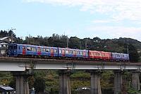 outdoor, train, sky, track, bridge, land vehicle, vehicle, text, rail, long, traveling, railroad
