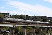 sky, outdoor, train, railroad, building, locomotive, rail, vehicle, land vehicle, bridge, colonnade