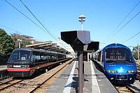 sky, train, outdoor, track, rail, vehicle, land vehicle, station, platform, transport, pulling, text, passenger, traveling, public transport, locomotive, railway, railroad, day