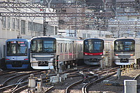 building, outdoor, track, land vehicle, vehicle, railroad, station, transport, rail, city, text, train, day