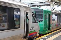train, platform, station, transport, land vehicle, vehicle, outdoor, public transport, passenger, railroad, text, passenger car, rolling stock, stopped