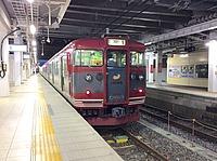 train, track, station, platform, building, railroad, rail, transport, land vehicle, vehicle, pulling, subway, passenger, pulled
