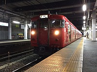 train, platform, station, track, building, railroad, rail, land vehicle, vehicle, ceiling, pulling, locomotive, railway, rolling stock, coming, stopped, pulled, traveling