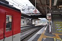 train, track, platform, station, railroad, rail, land vehicle, text, transport, train station, vehicle, public transport, metro station, stopped