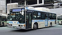 road, bus, building, outdoor, vehicle, land vehicle, street, text, transport, city, parked, curb