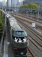 track, train, outdoor, rail, station, locomotive, vehicle, land vehicle, transport, passenger, railway, traveling, train station, rolling stock, railroad, way, road, highway