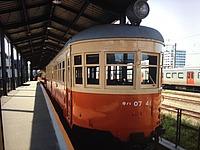 train, land vehicle, vehicle, station, platform, orange, pulling