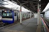 train, station, track, platform, land vehicle, vehicle, rail, subway, pulling, stopped, empty, railroad, long, pulled