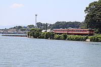 water, sky, outdoor, train, vehicle, river, tree, lake, traveling, shore, boat