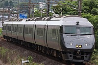 train, outdoor, track, transport, grass, land vehicle, rail, vehicle, traveling, railroad, day, several