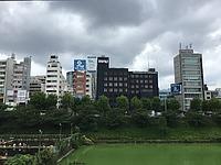 sky, grass, outdoor, skyscraper, building, cloud, tree, city, park, golf, cloudy