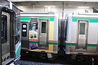 train, indoor, land vehicle, subway, public transport, vehicle, text, station, rolling stock