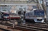 track, train, building, outdoor, railroad, rail, transport, land vehicle, vehicle, locomotive, station, city, traveling