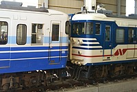 train, track, transport, blue, land vehicle, vehicle, outdoor, rail, rolling stock, locomotive, railway, traveling, railroad