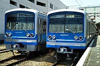 train, track, transport, outdoor, blue, land vehicle, vehicle, station, platform, rail, pulling, traveling, railroad