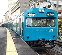train, track, building, outdoor, platform, transport, station, blue, railroad, land vehicle, vehicle, rail, pulling, traveling