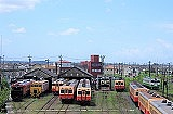 sky, outdoor, train, track, locomotive, vehicle, rail, text, land vehicle, way, road, railroad, line, lined, several, highway, day