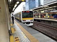 train, track, building, platform, station, land vehicle, vehicle, text, rail, pulling, traveling, railroad