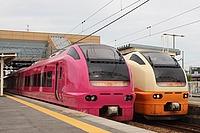 sky, outdoor, land vehicle, transport, vehicle, railroad, public transport, rail, station, rolling stock, platform, railway, passenger car, pulling, train