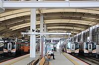 train, building, station, track, platform, land vehicle, vehicle, indoor, text, public transport, pulling, warehouse