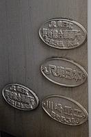 text, coin, metal, plaque