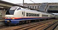 train, track, building, outdoor, sky, transport, rail, land vehicle, vehicle, station, railway, locomotive, pulling, traveling, railroad