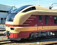 train, outdoor, sky, track, transport, land vehicle, vehicle, rail, rolling stock, railway, public transport, passenger car, locomotive, station, railroad car, traveling, railroad