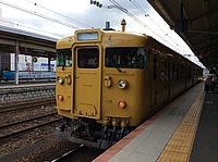 train, track, transport, platform, station, outdoor, railroad, land vehicle, rail, vehicle, yellow, rolling stock, pulling, stopped