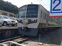 sky, outdoor, transport, land vehicle, railroad, vehicle, train, text, rail, station, day, several