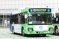 road, bus, green, text, vehicle, land vehicle, outdoor, street, transport, driving, city, day