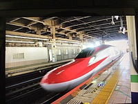 train, indoor, vehicle, land vehicle, bullet train, high-speed rail, train station, public transport, railway, text, metro station, station, transport, transport hub, rolling stock