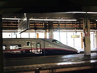 train, vehicle, indoor, land vehicle, station, bullet train, railroad, public transport, high-speed rail, train station, railway, transport, rail, transport hub, rolling stock, silver