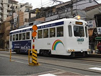 road, outdoor, land vehicle, transport, vehicle, street, tram, text, city, streetcar, train, traveling