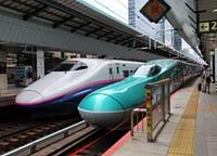 station, indoor, vehicle, platform, land vehicle, bullet train, text, transport, high-speed rail, public transport, train station, railway, transport hub, train