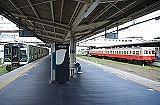 train, station, building, platform, track, vehicle, land vehicle, railroad, text, rail, pulling, train station, empty, pulled